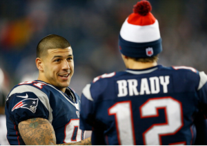 Aaron Hernandez with teammate Tom Brady, while playing for the New England Patriots.